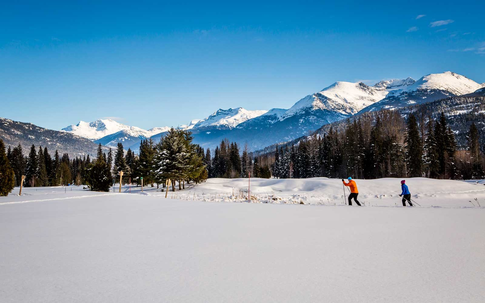 Couple cross country skiing in Whistler, British Columbia, Canada