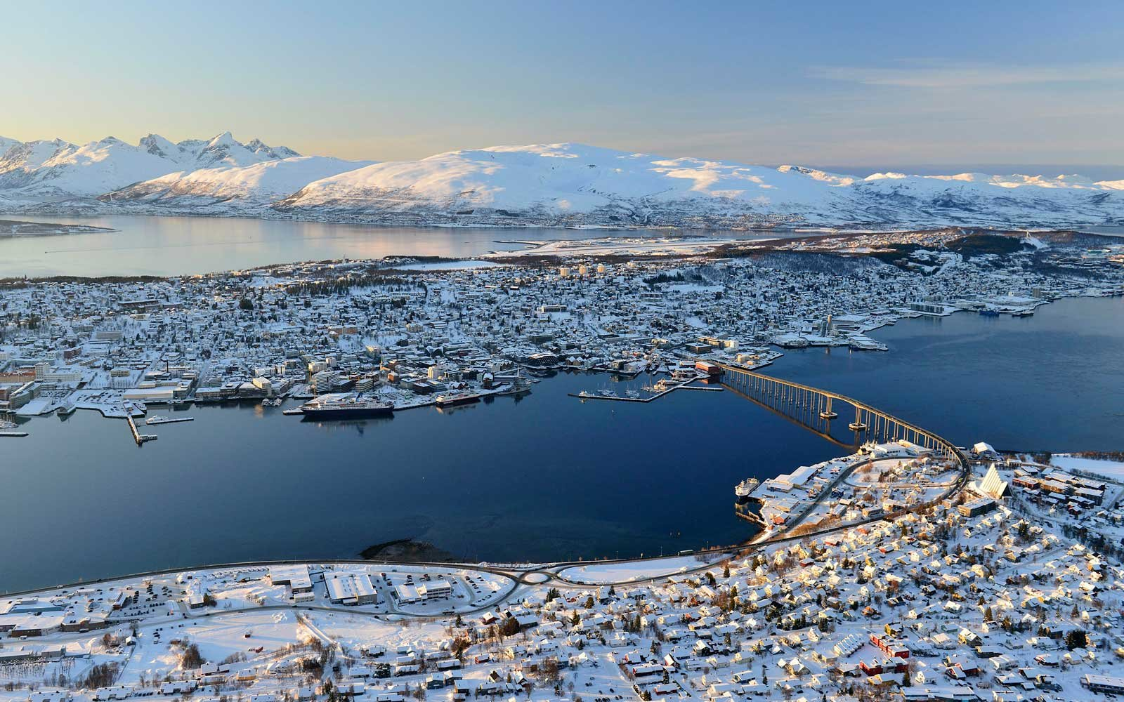 Snowy town with bridge, islands in the North Sea, Tromsoe, Tromsoeysund, Troms, Norway