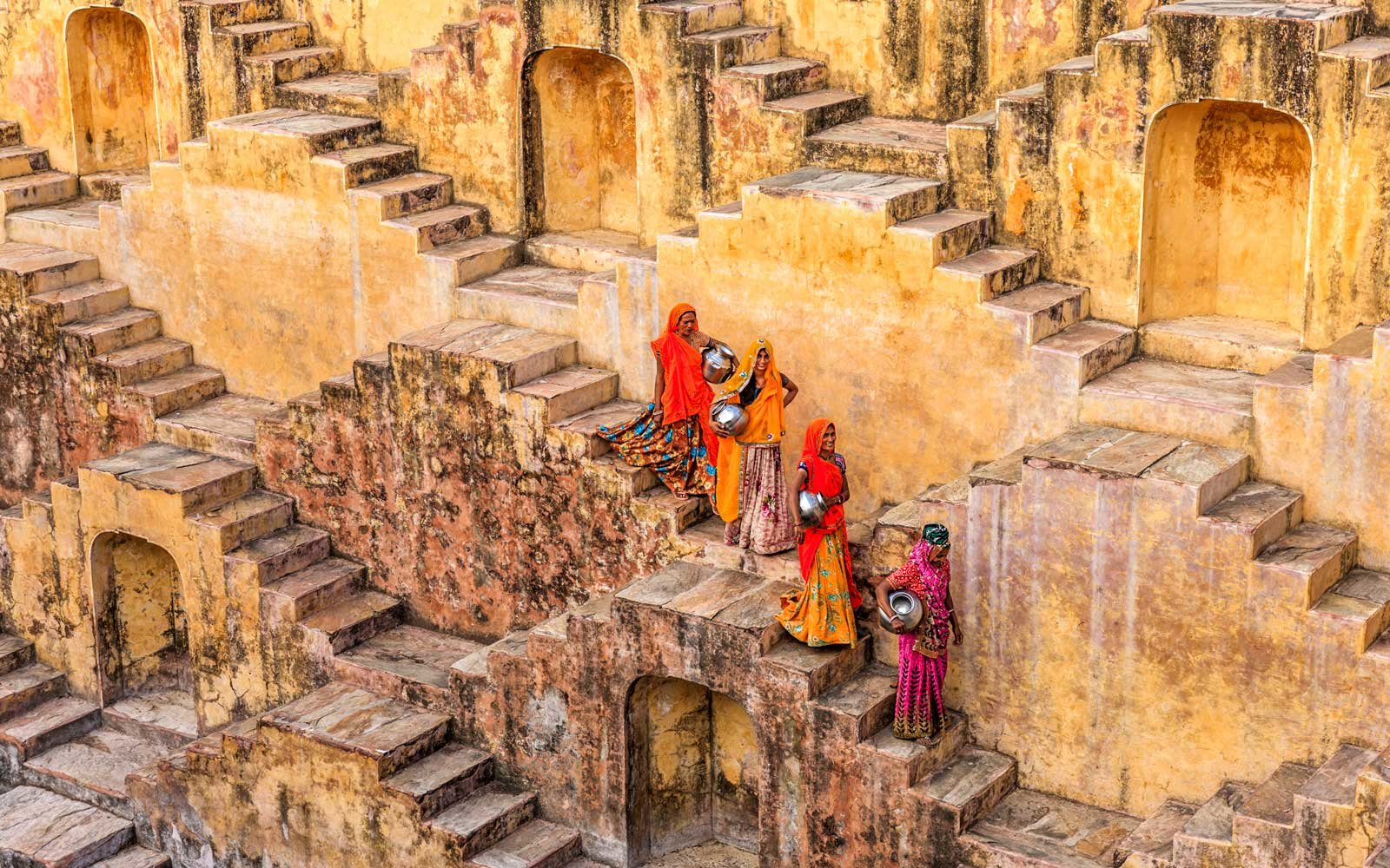 Indian women carrying water from stepwell near Jaipur, India