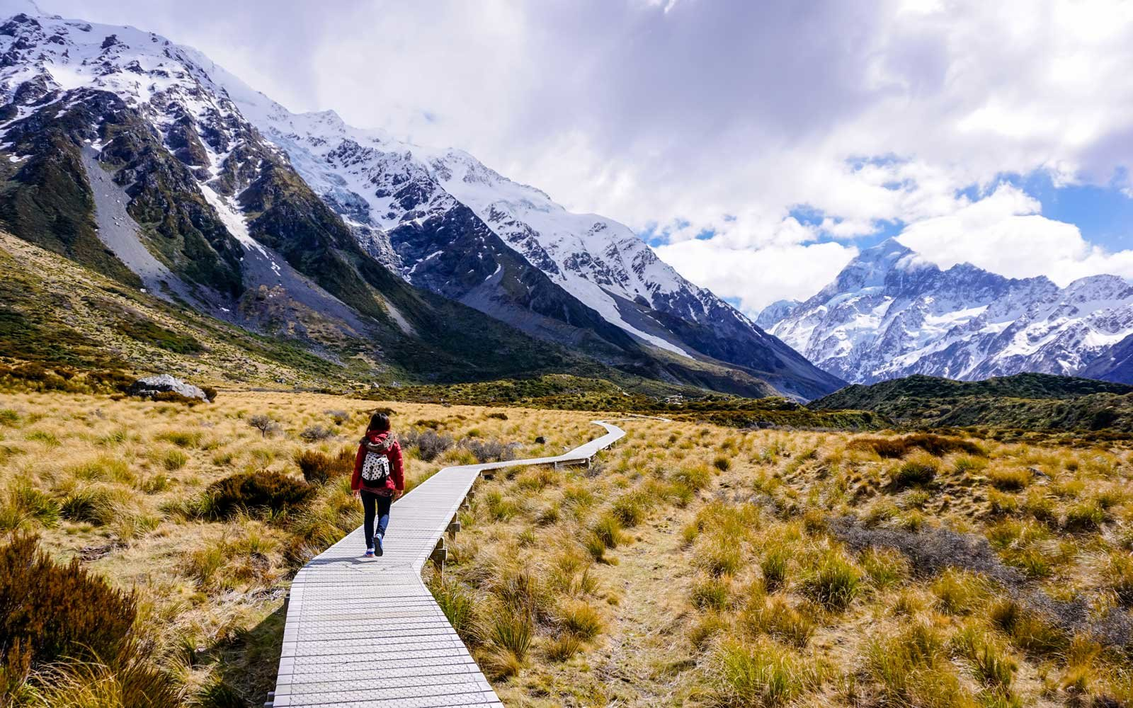 Woman walking through Hooker Valley trail, Mt Cook national park, New Zealand