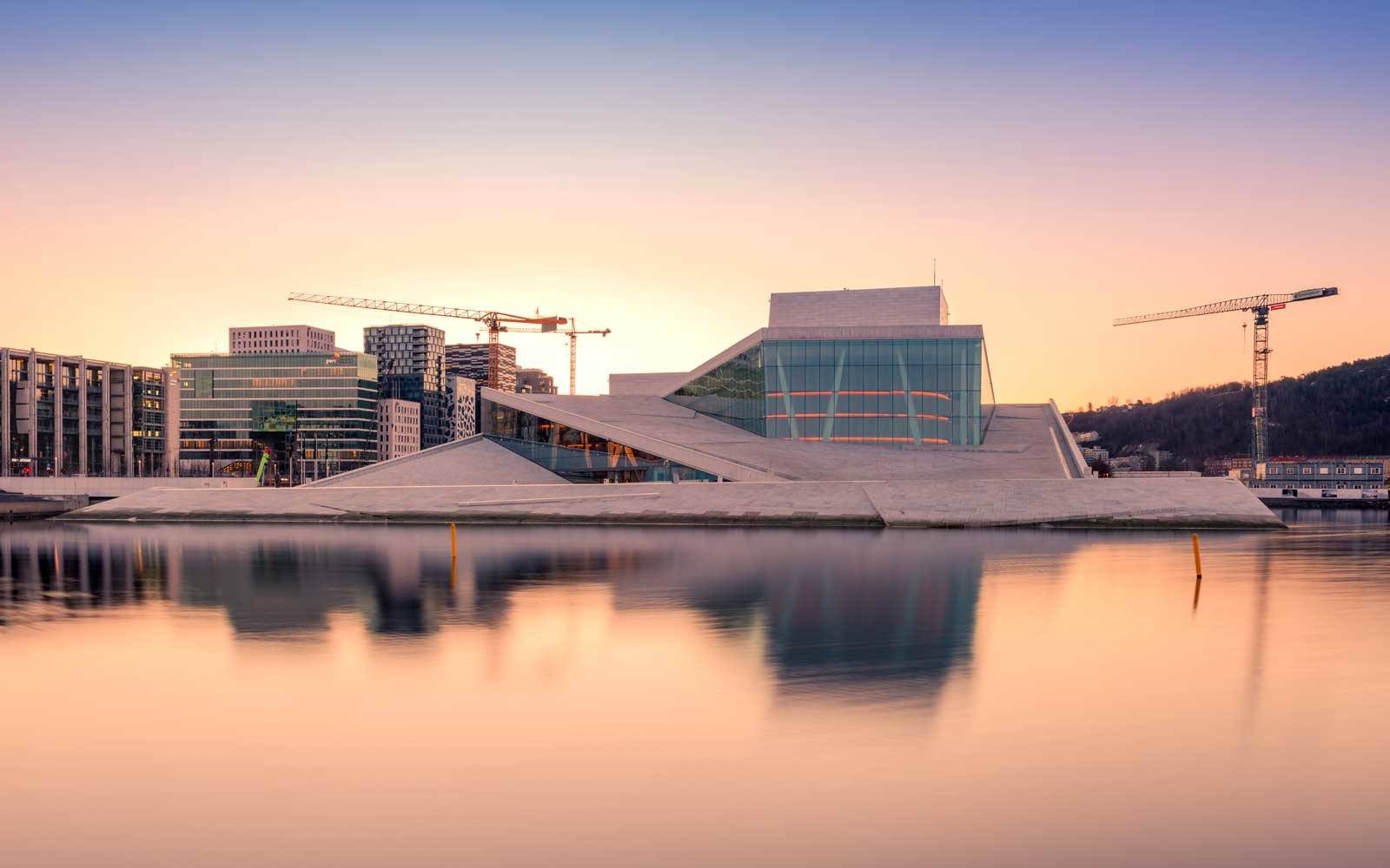 The morning view of Oslo Opera House with water reflection