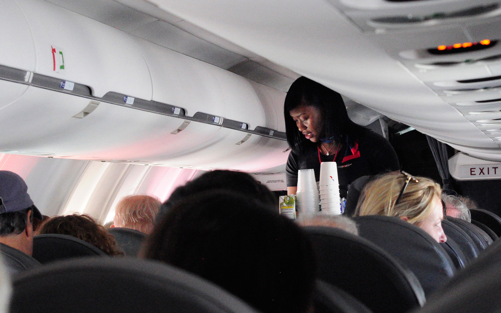 American Airlines crew can offer compensation in-flight.