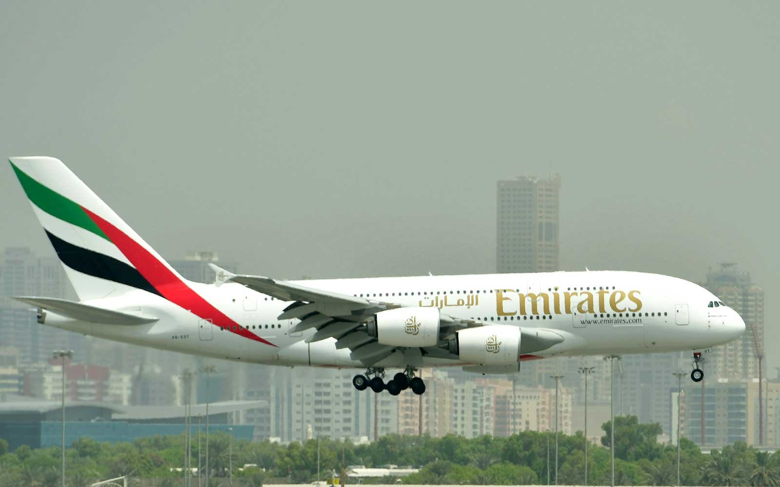 Airbus A380 of Emirates landing at the tarmac at Dubai's International Airport