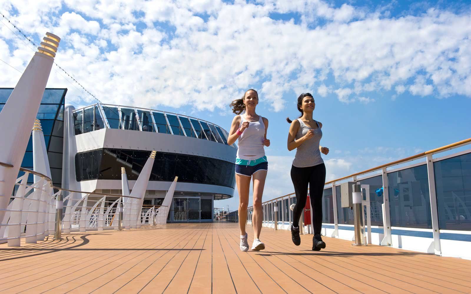 Two women running on board the MSC Preziosa ship