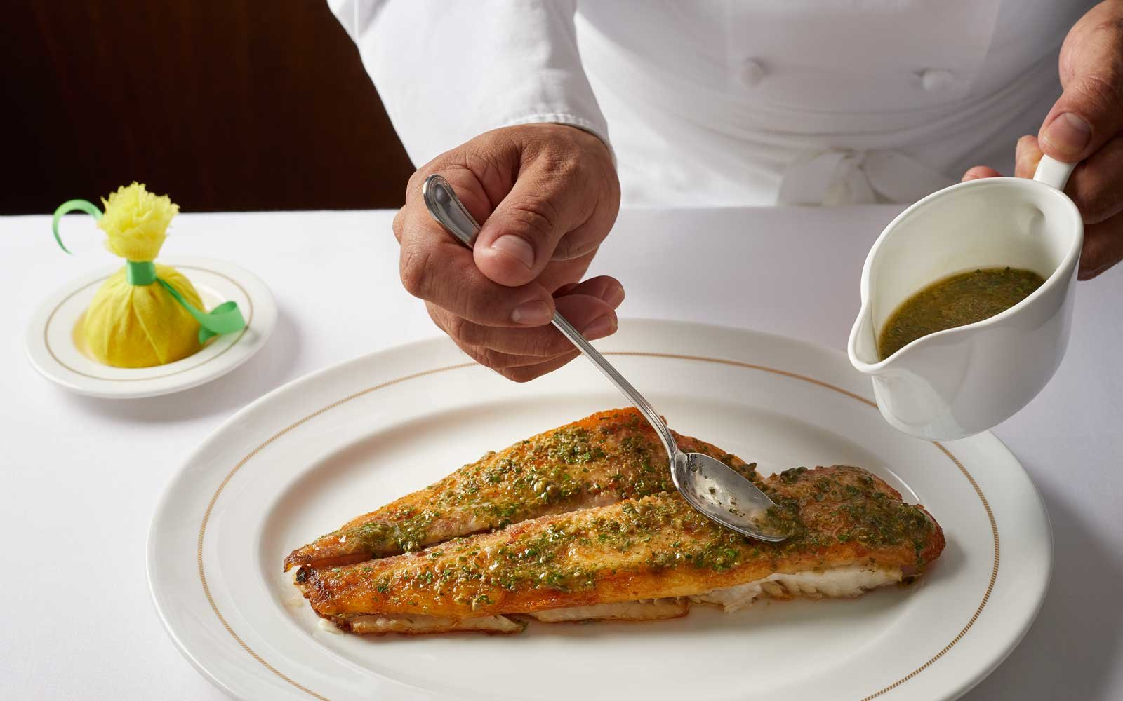 Thomas Keller prepares dover sole for the Seaboard Encore ship