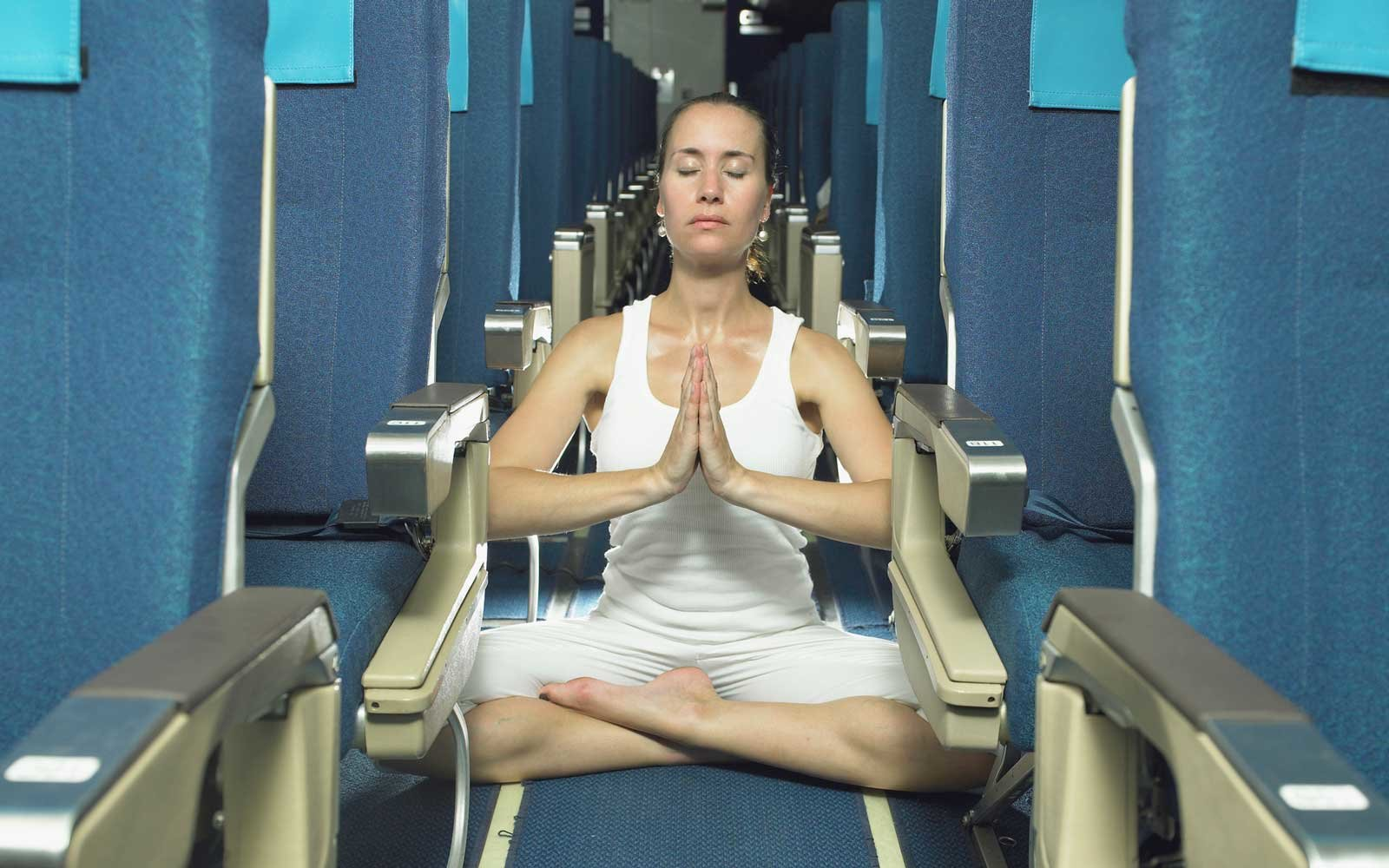 Yoga pose on airplane