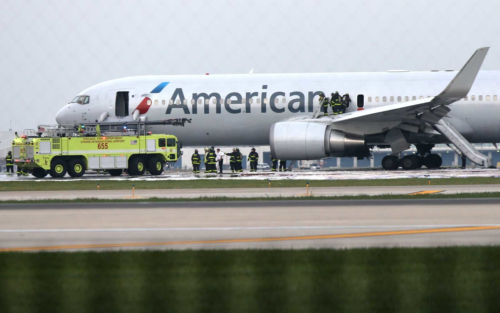 8 injured when plane catches fire on runway at O'Hare