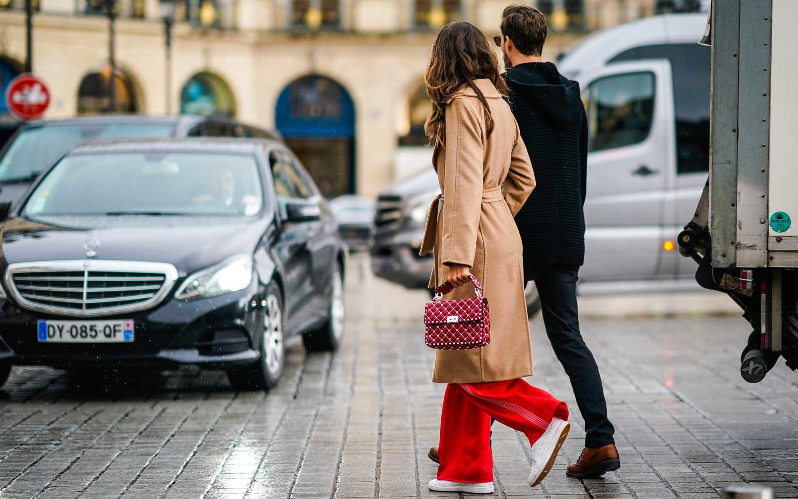 Stylish couple walking on the streets of Paris