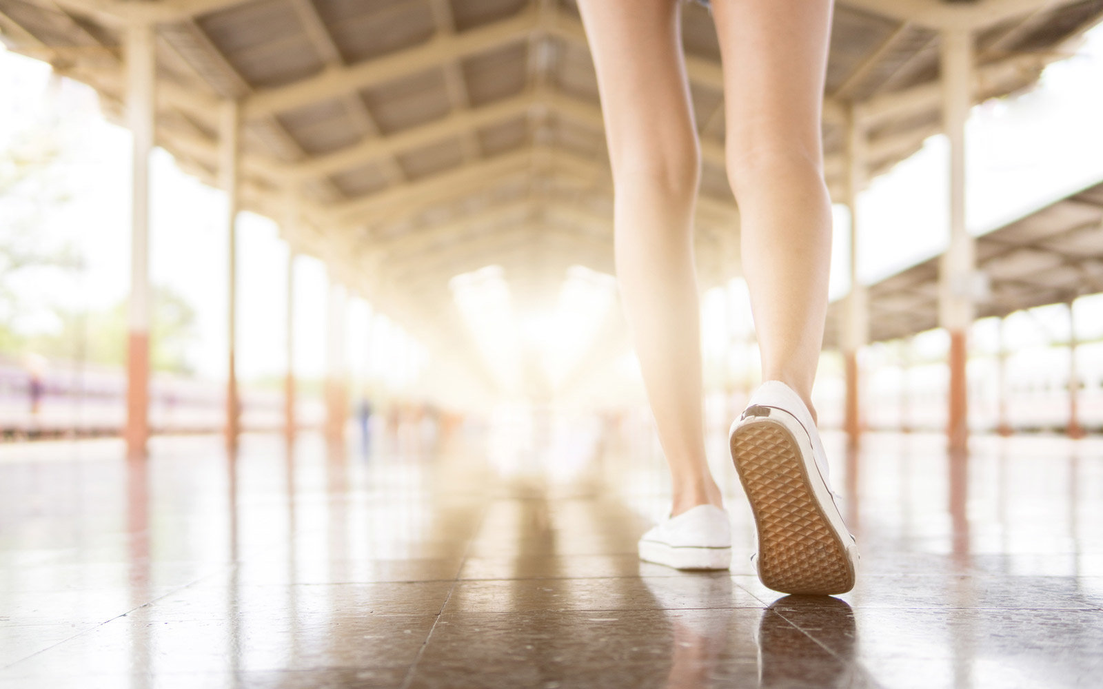 Low Section Of Woman Walking On Floor