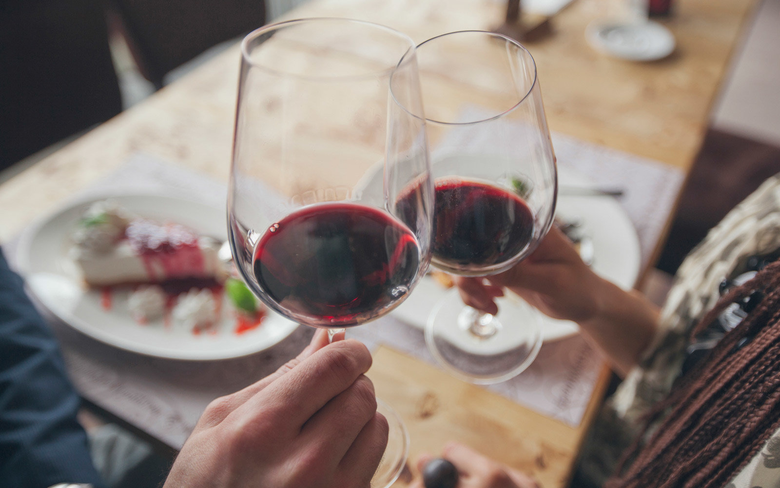 Couple toasting with wine in cafe