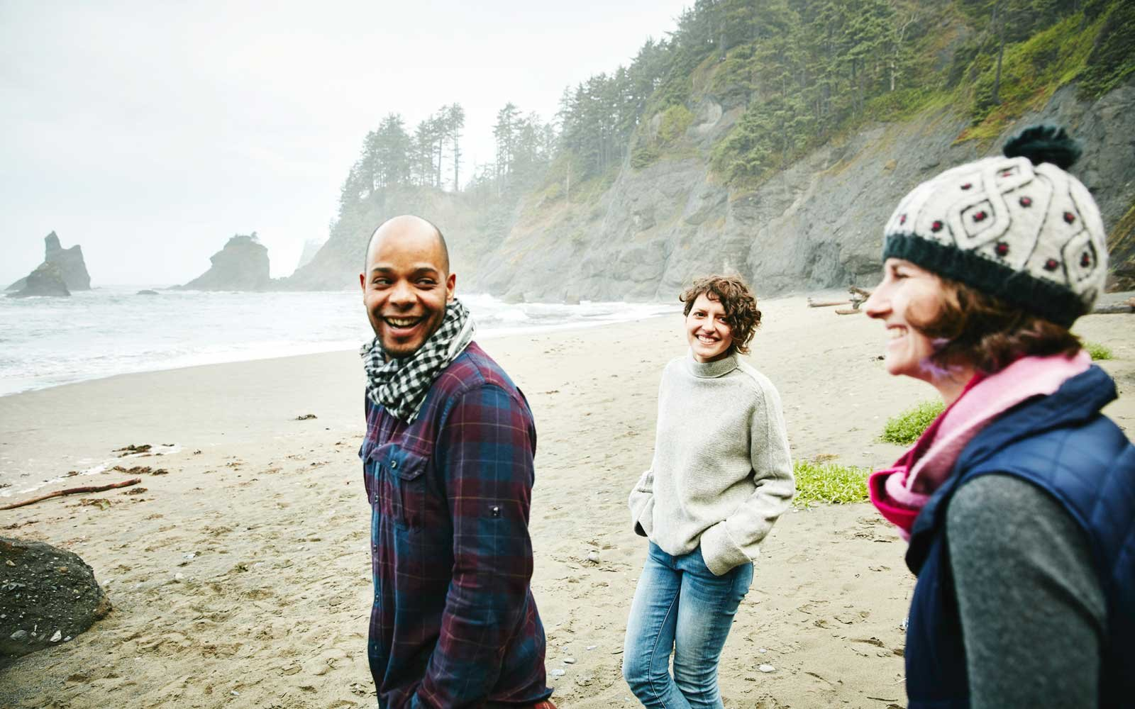 Group of friends exploring remote beach together