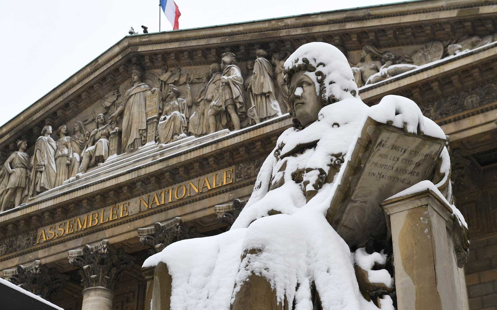 A snow covered statue is pictured in front of the National Assembly, on February 7, 2018 in Paris, following heavy snowfall.