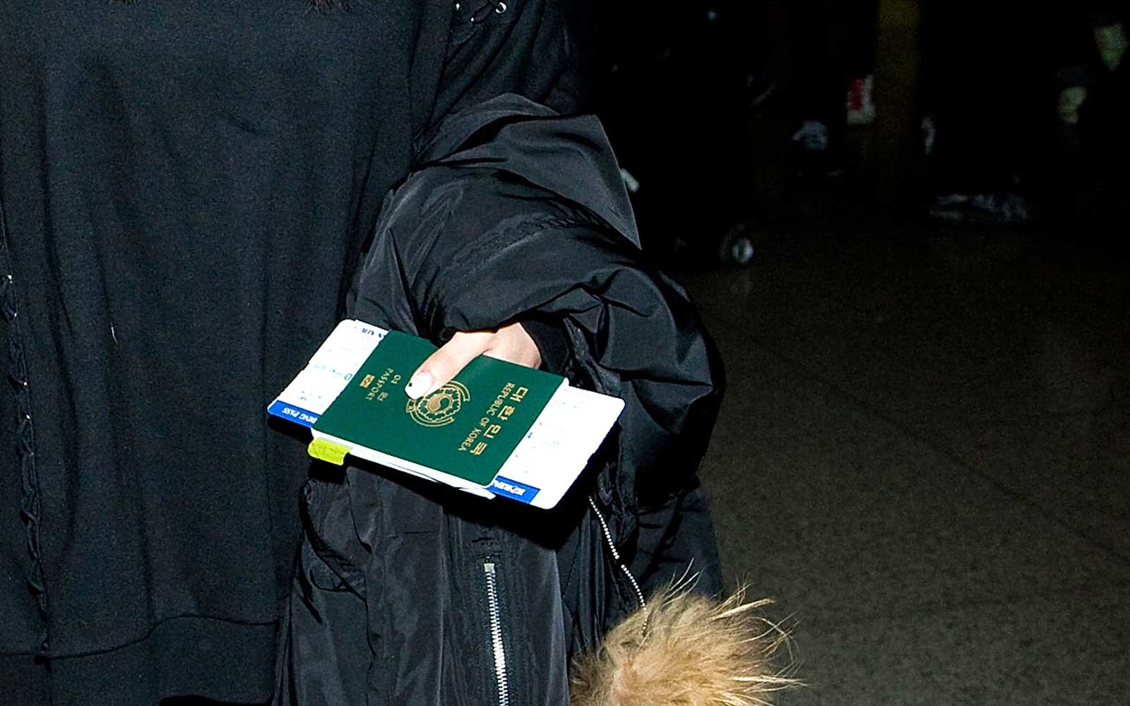 Traveler holding South Korean Passport at the Airport
