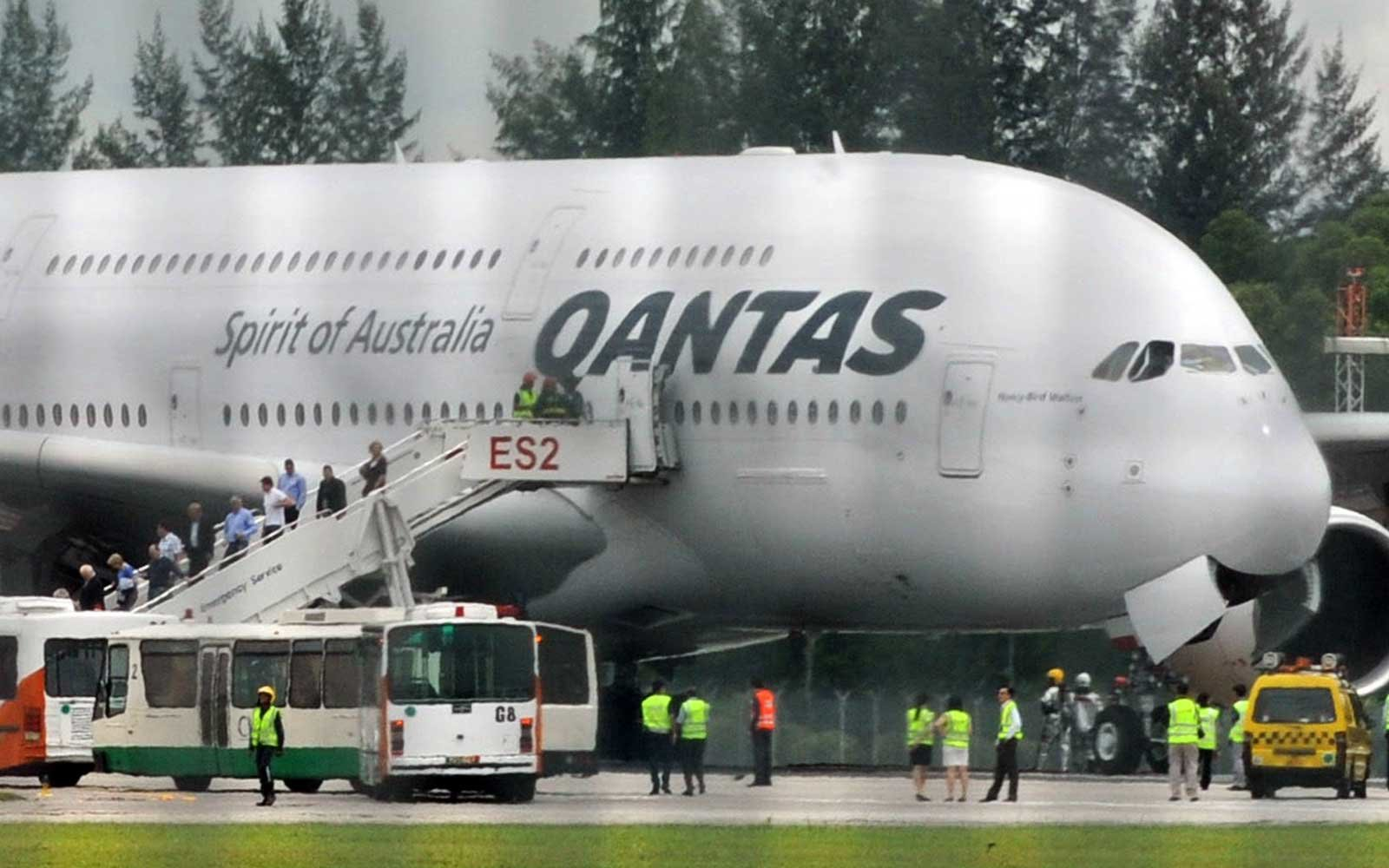 Passengers unboard a troubled Qantas Air