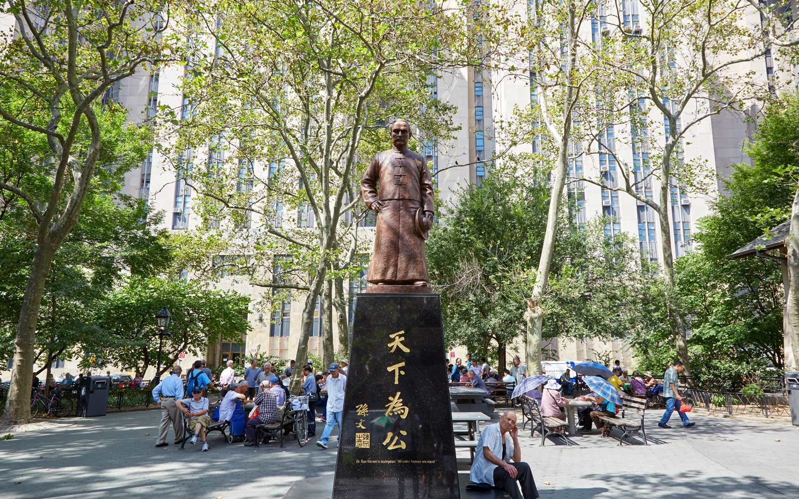Columbus Park with people playing Chinese Chess and Sen Yat-sen statue in New York