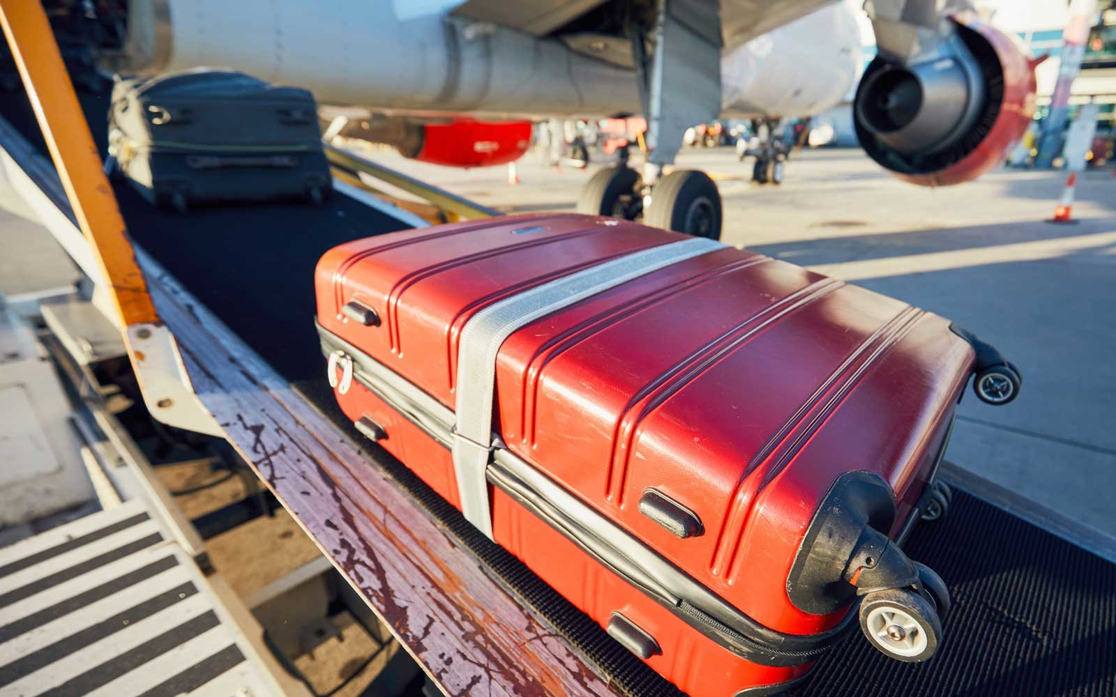 Luggage Loading Into Airplane