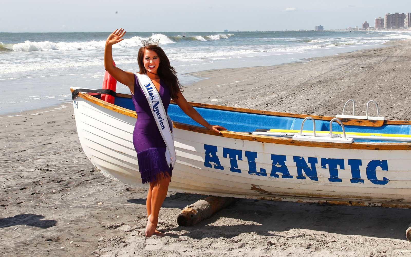 The newly crowned Miss America 2018 dips her toe in the ocean after the 2018 Miss America Competition