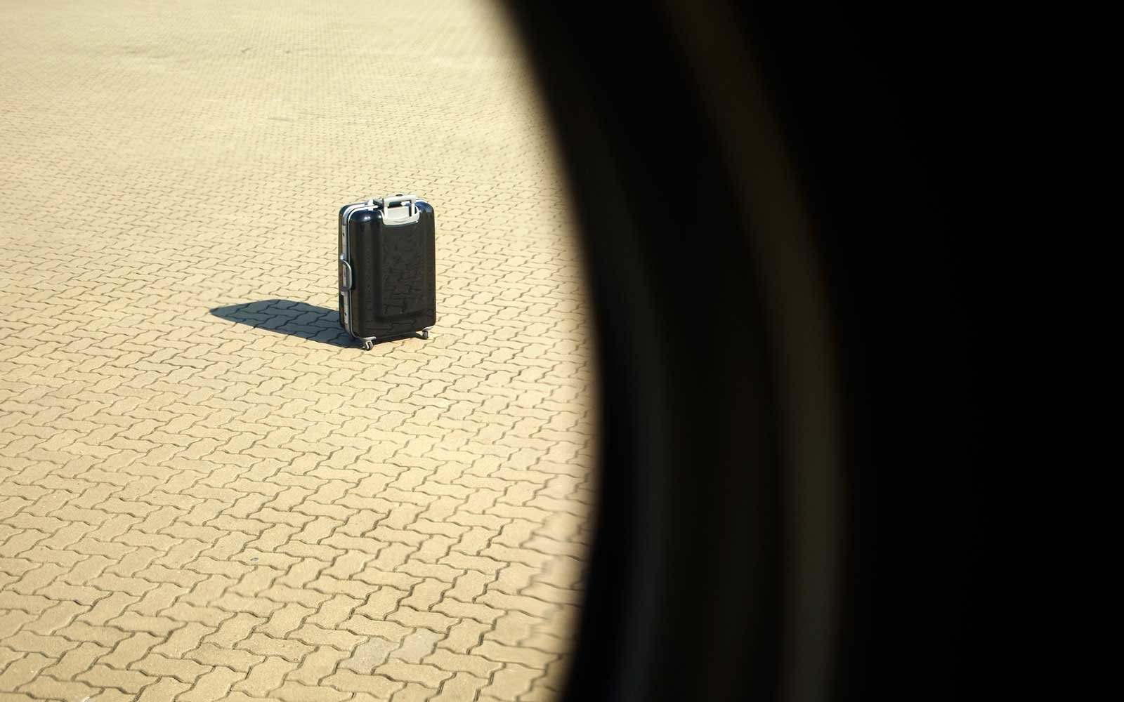 Suitcase Outside of Airplane Window
