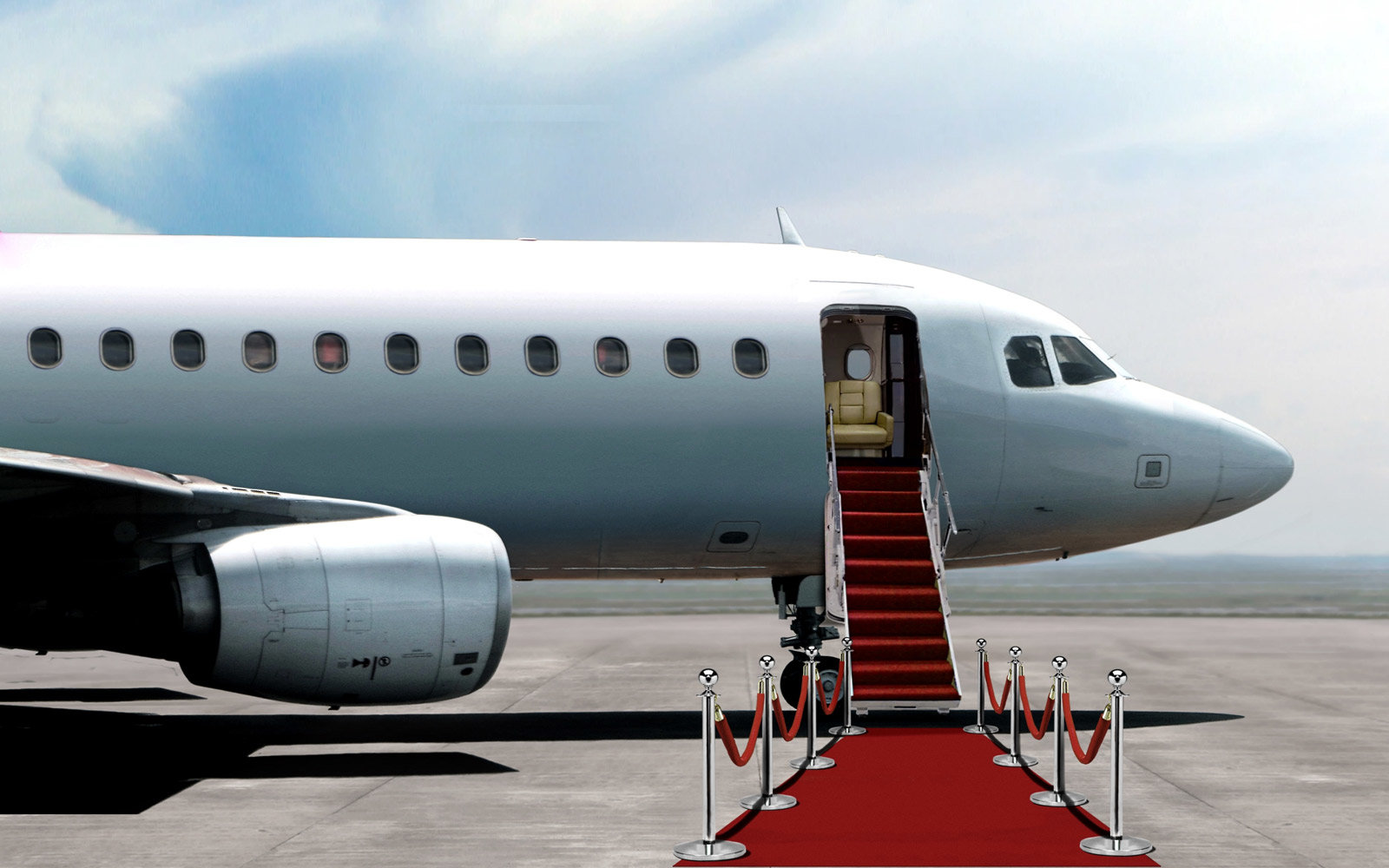 Airplane departure entrance with red carpet