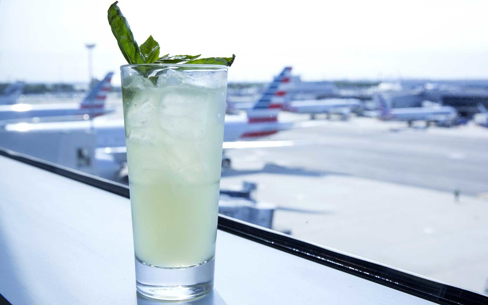 Drink with a view of planes at the airport