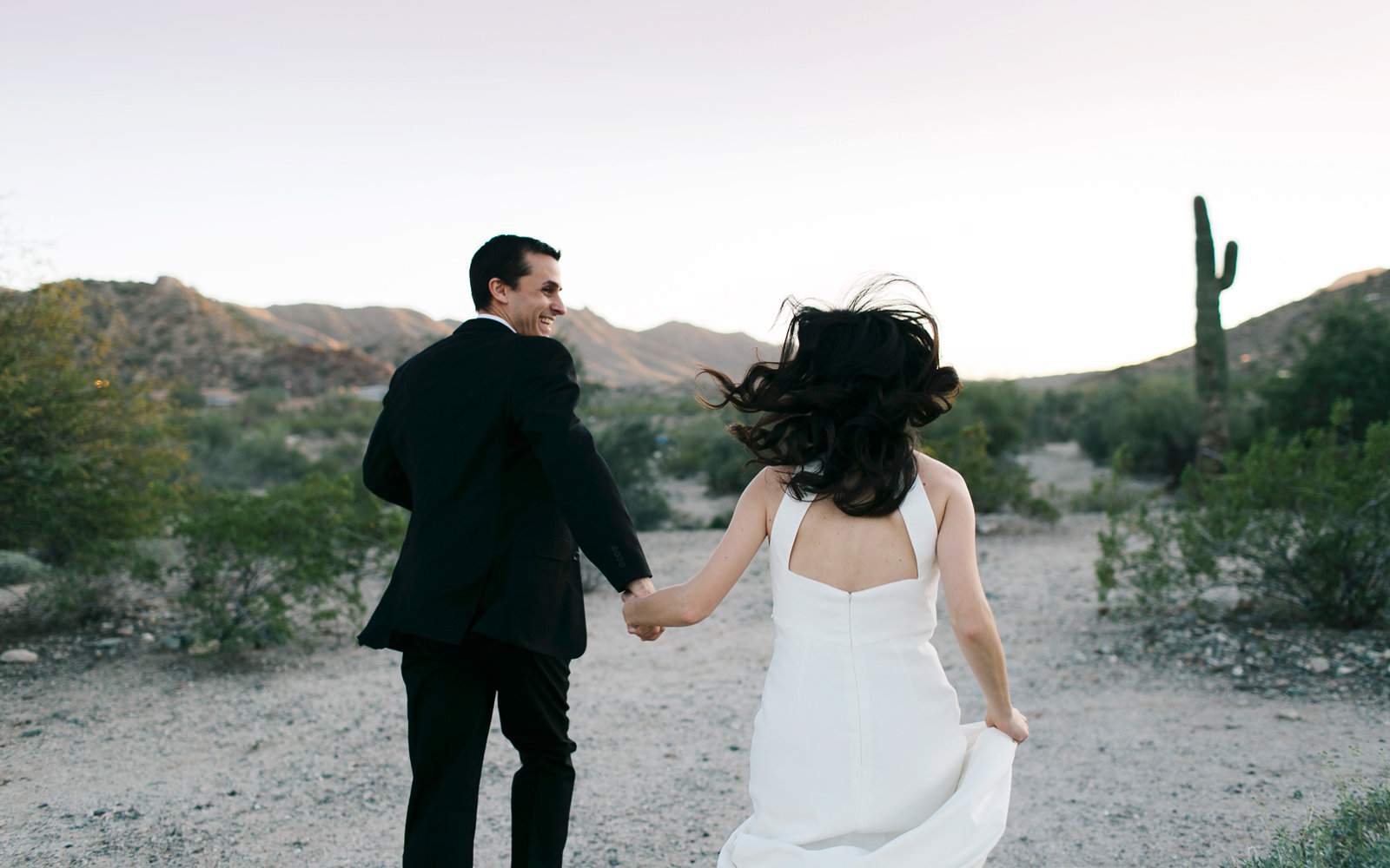 Bride and groom in desert landscape