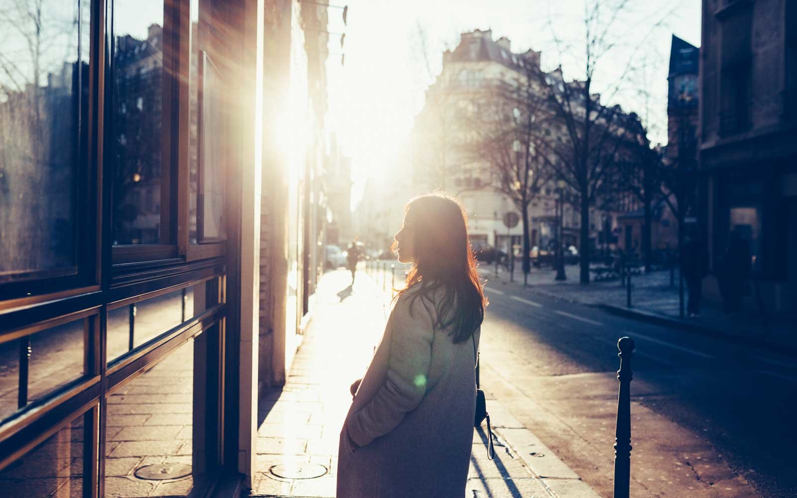 Woman walking on the streets of paris at dawn