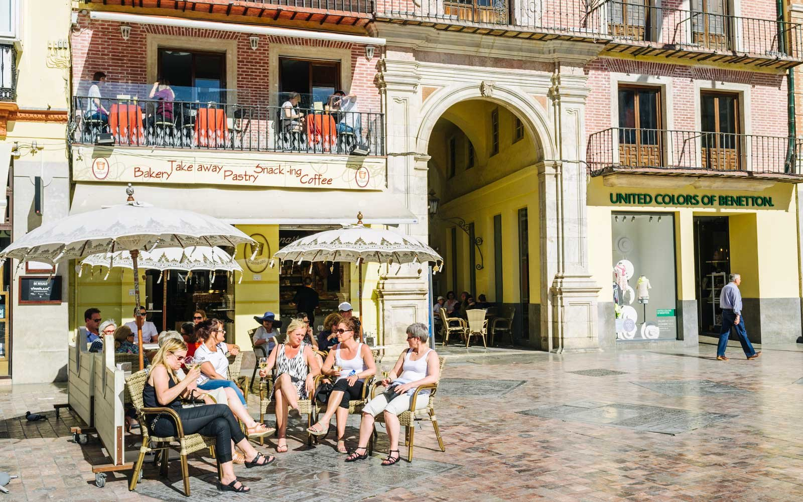Tourists at an outdoors bar in the historic centre of Malaga