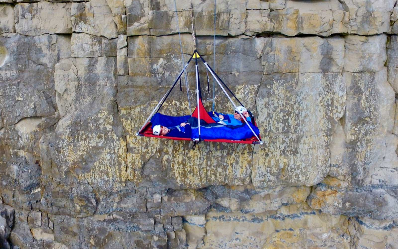 u0026 39 cliff camping u0026 39  lets you sleep in a bed dangling 60 feet