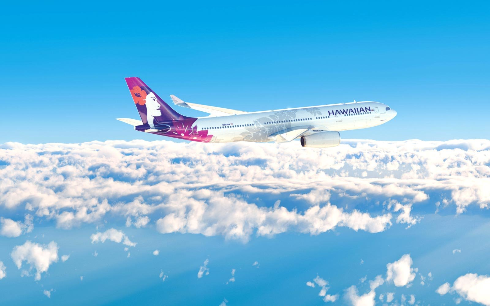 Hawaiian Airlines plane in flight over clouds