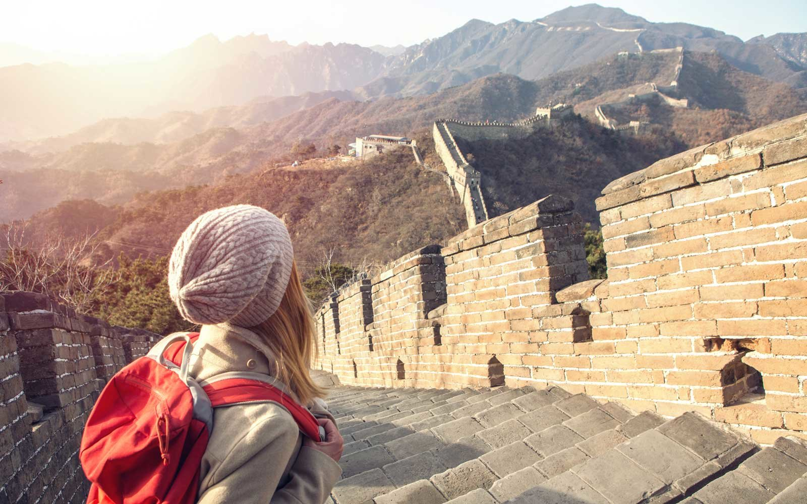 Young woman hiking the Great Wall of China