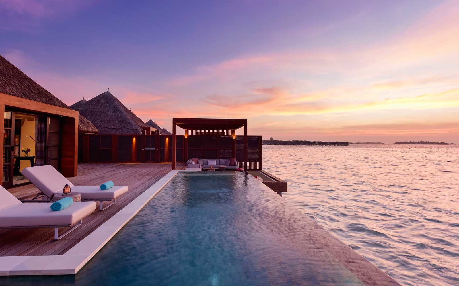 Sunset at the Four Seasons Resort Maldives at Kuda Huraa