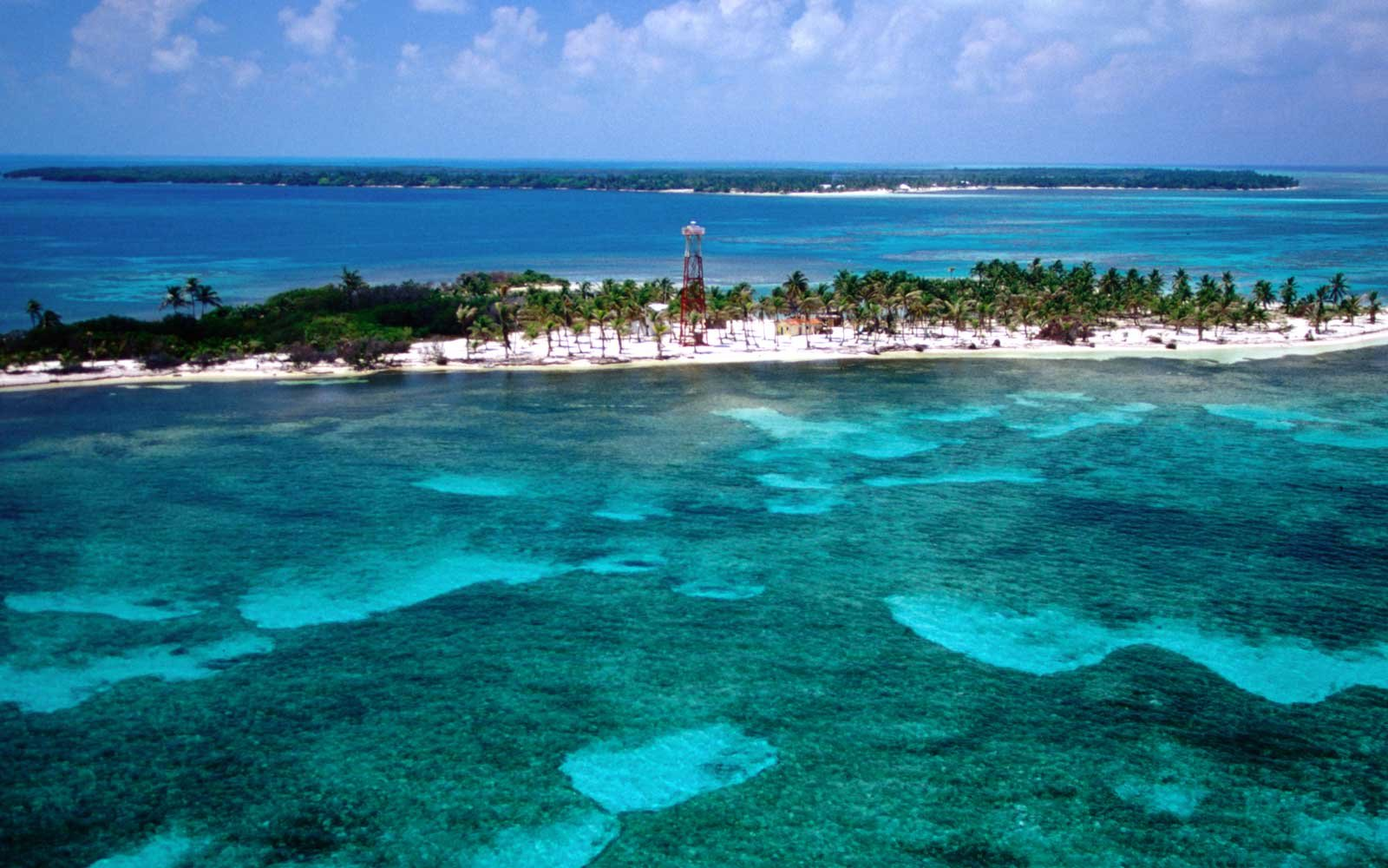 Tropical reefs surround Turneffe Island, a coral atoll which houses the Turneffe Islands Lodge.