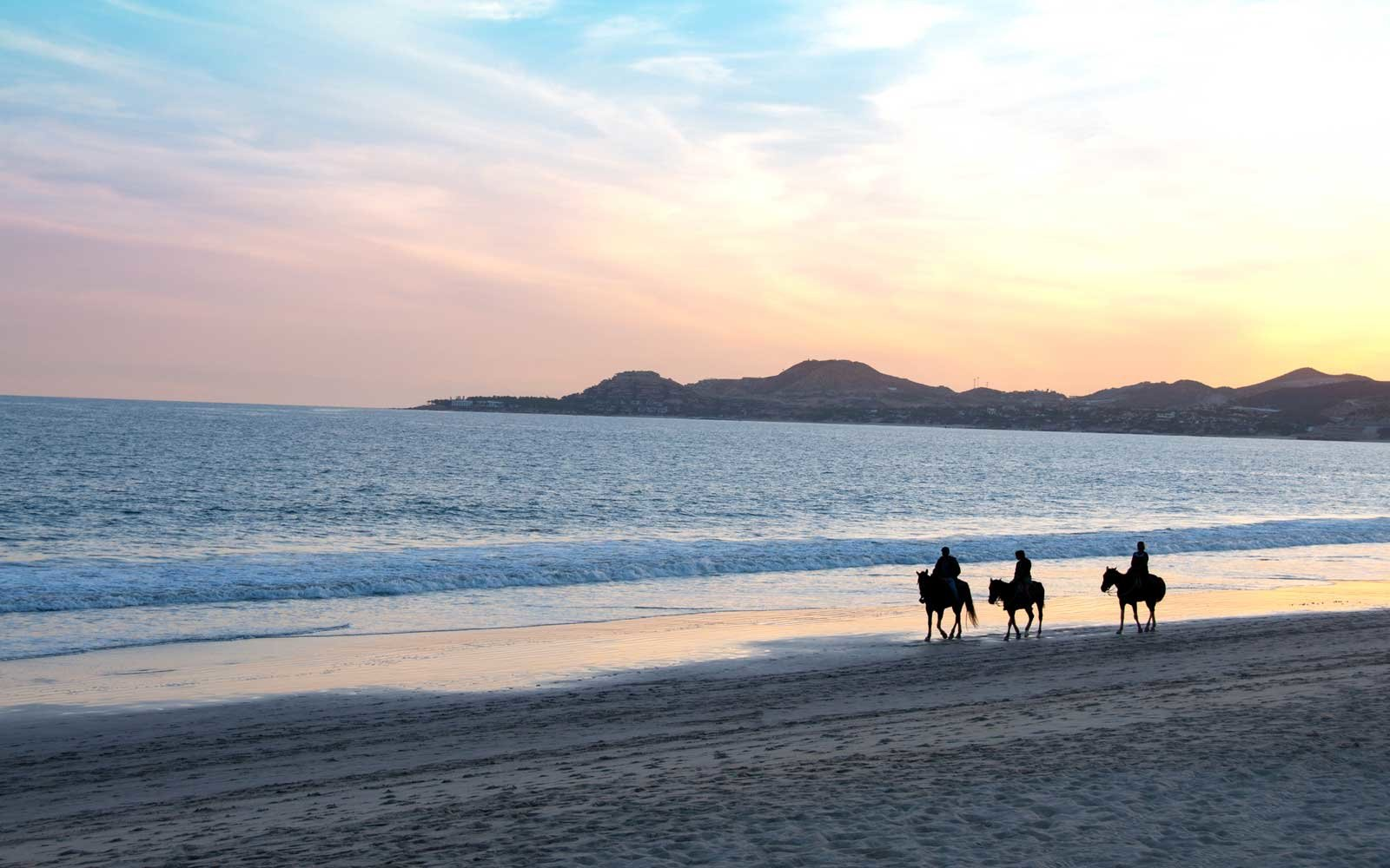Cabo San Lucas sunset, with horseback riders