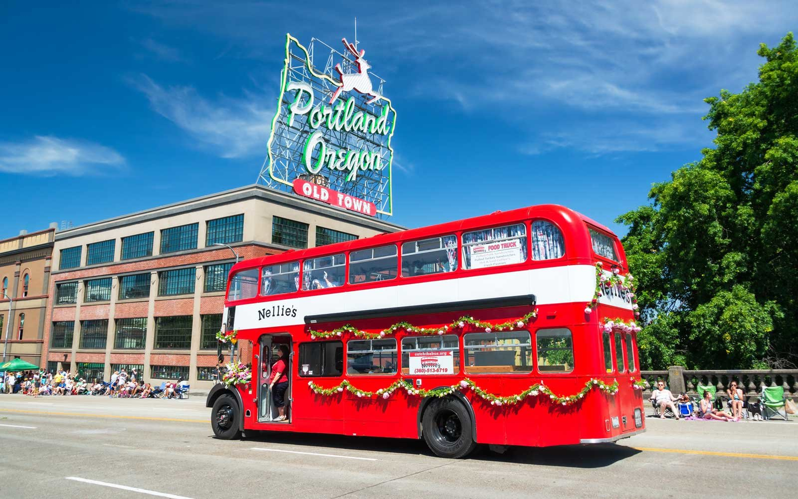 Portland, Oregon, USA - June 6, 2015: Red double decker bus passes as part of the Grand Floral Parade on June 6, 2015 in Portland, Oregon