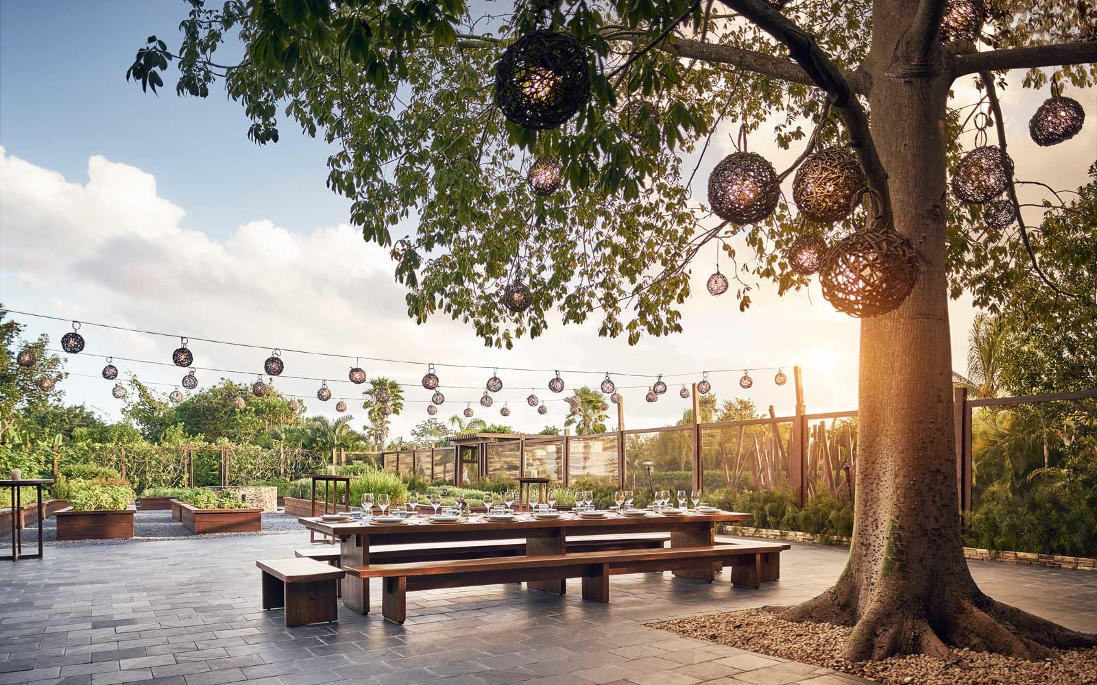 Outdoor dining setup at the Rosewood Mayakoba resort