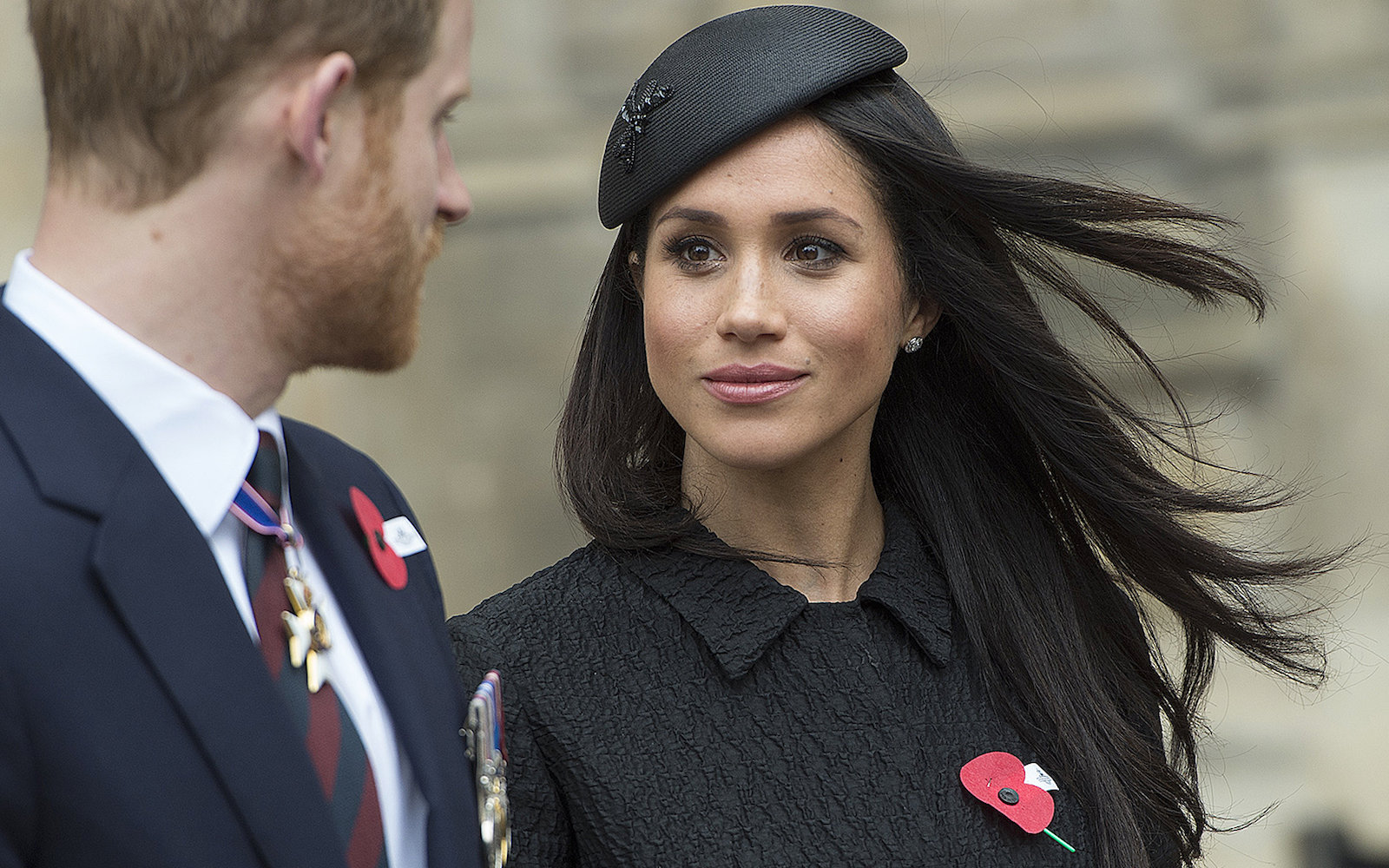 Britain's Prince Harry (L), his US fiancee Meghan Markle (C), and Britain's Prince William, Duke of Cambridge, attend a service of commemoration and thanksgiving to mark Anzac Day in Westminster Abbey in London on April 25, 2018.