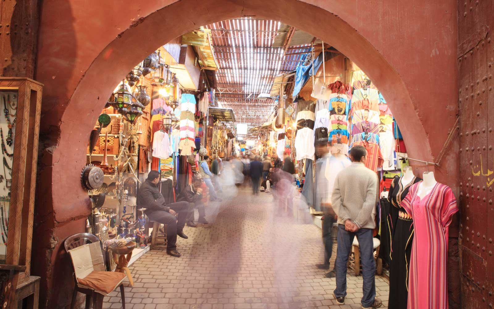 Morocco, Marrakech. Shoppers in medina