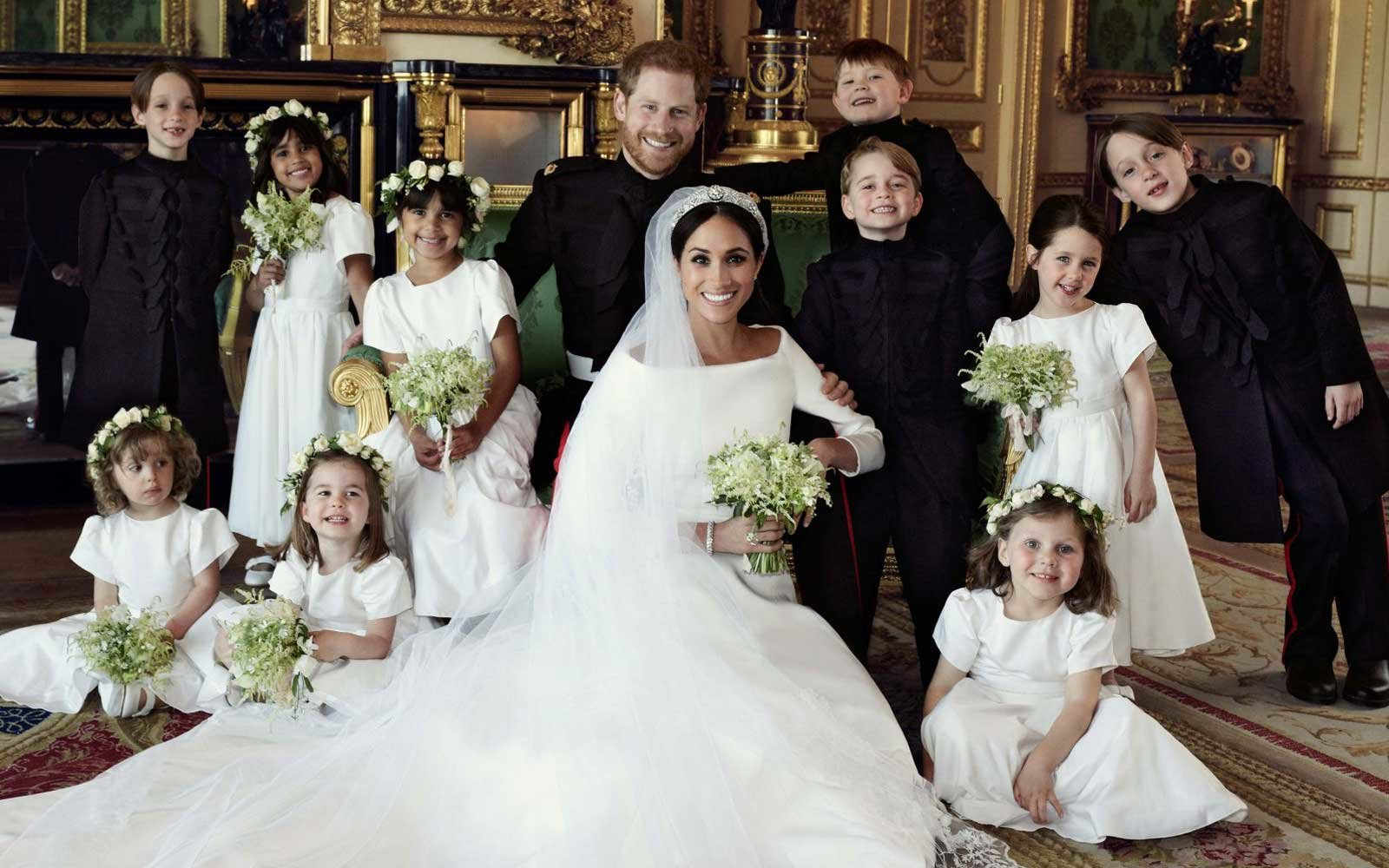579f9affb158 Harry and Meghan's Photographer Revealed the Real Reason Prince George Was  Grinning in That Royal Wedding Portrait | Travel + Leisure