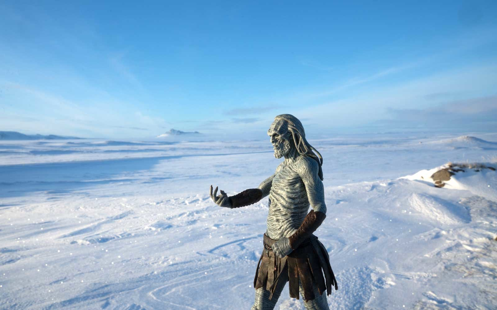 White walker figurine against a blue sky in Iceland