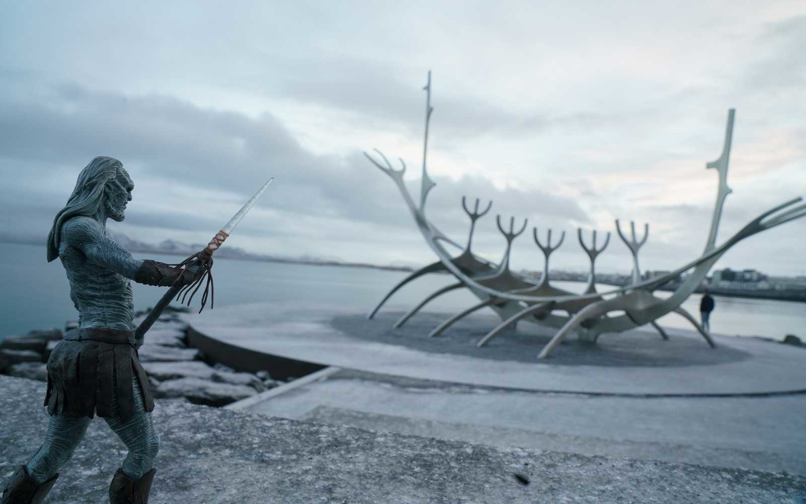 White Walker figurine in Iceland, near a viking ship sculpture