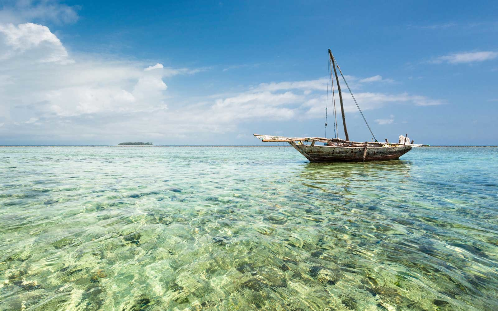 Dhow on the clear waters in Zanzibar
