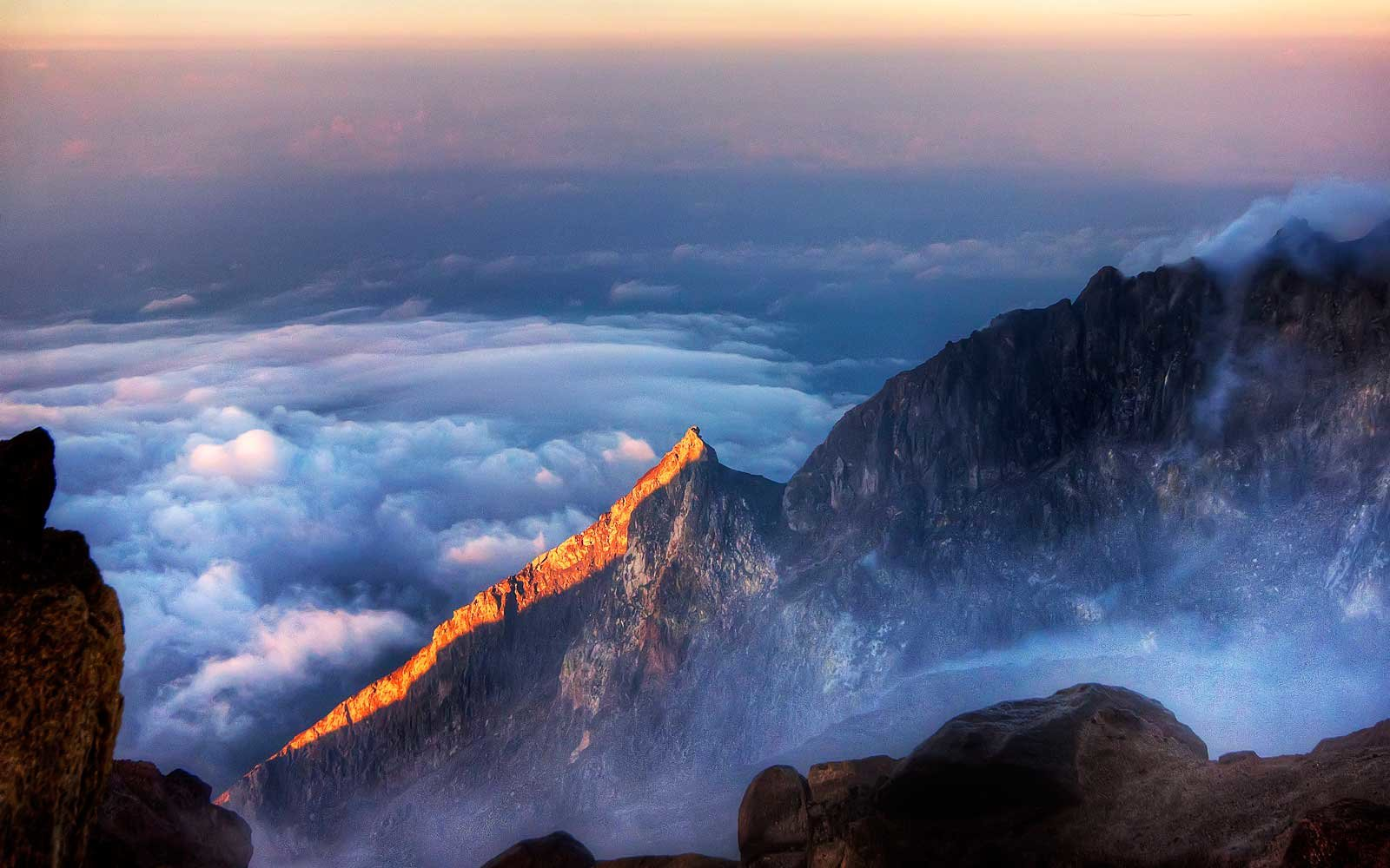 Mount Merapi volcano next to Yogyakarta at dawn.