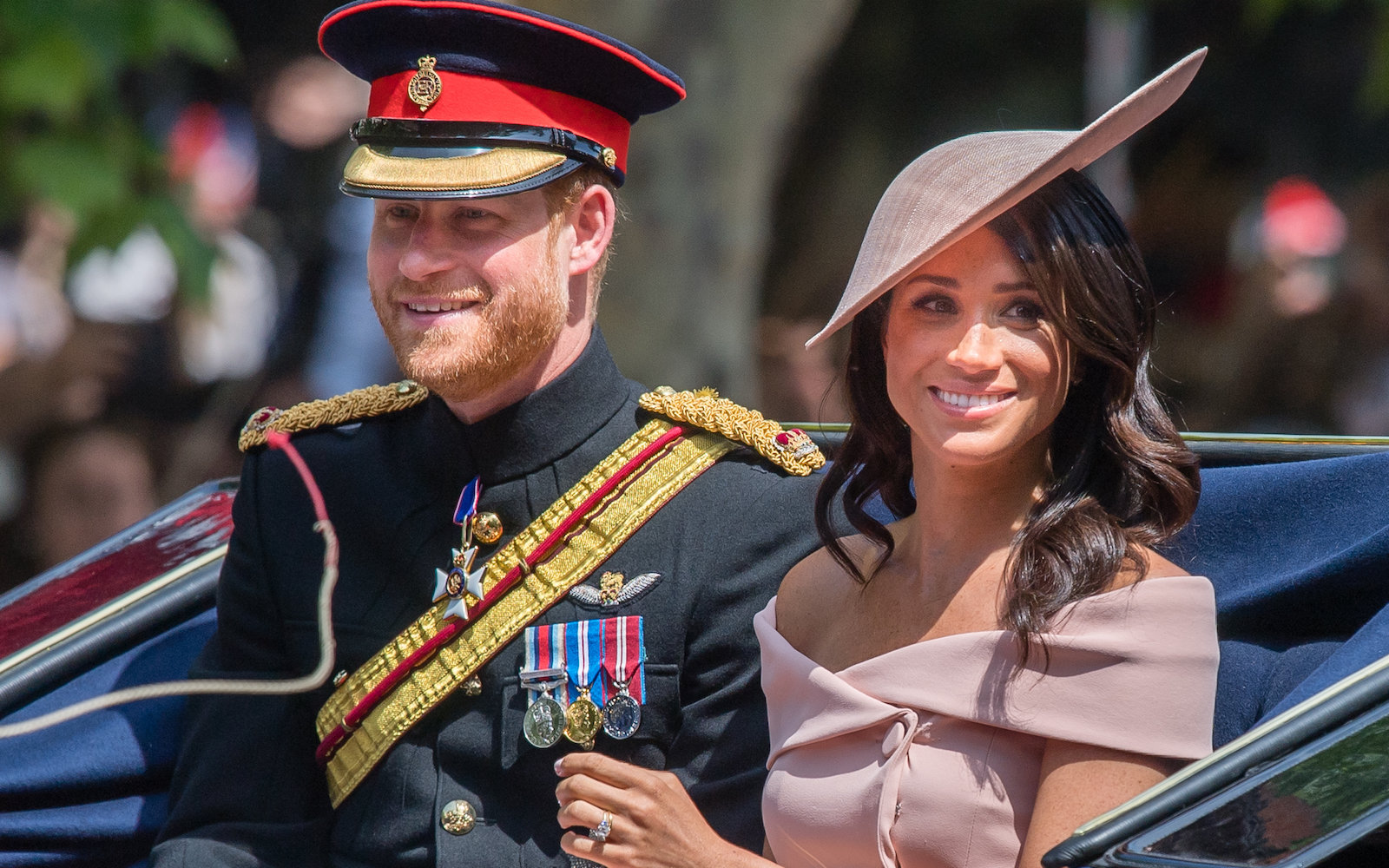 Prince Harry, Duke of Sussex and Meghan, Duchess of Sussex ride by carriage during Trooping The Colour 2018 on the Mall on June 9, 2018 in London, England.