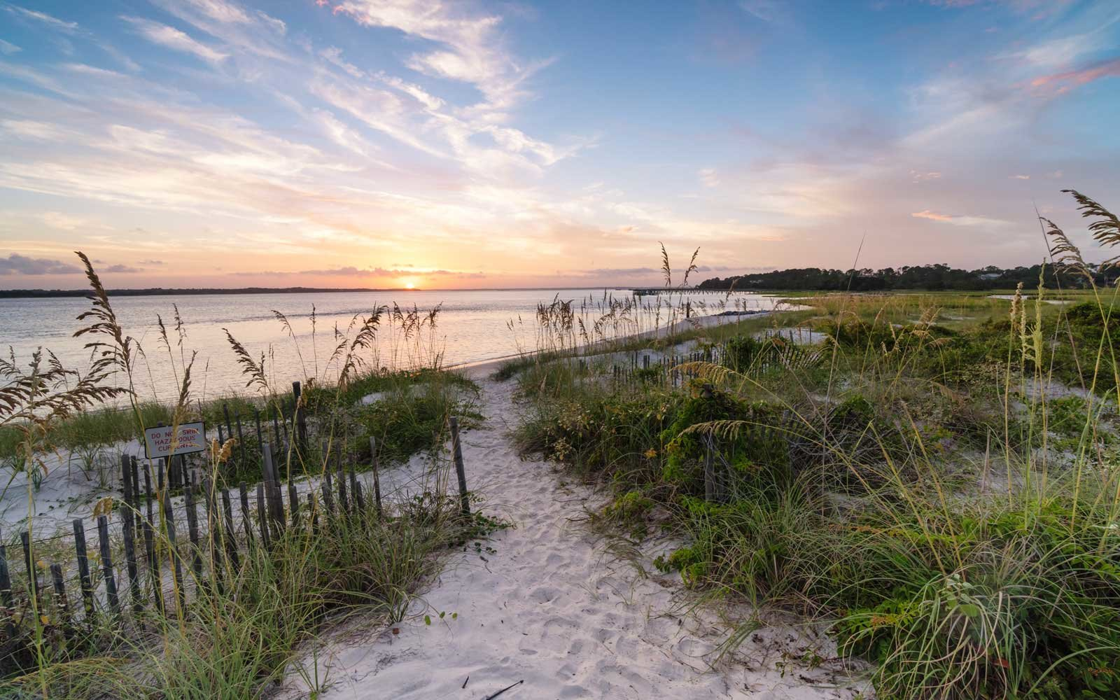 Beautiful sunset through the dunes of the South End of Amelia Island, Florida
