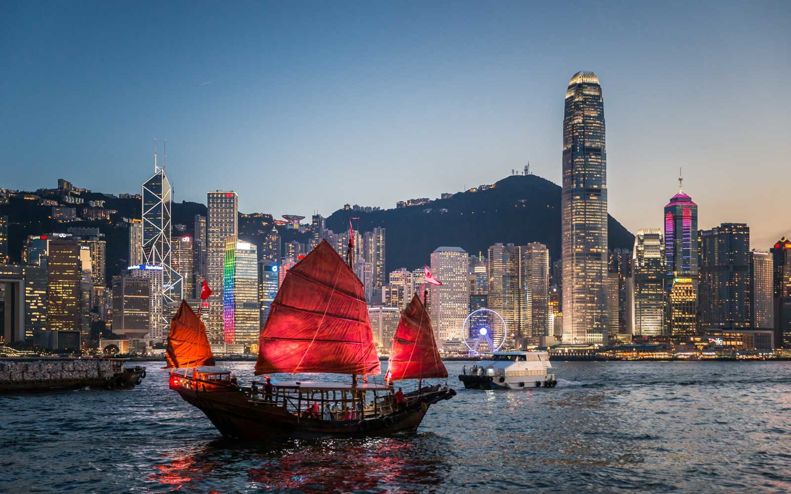 Traditional junk boat sailing across Victoria Harbour, Hong Kong.
