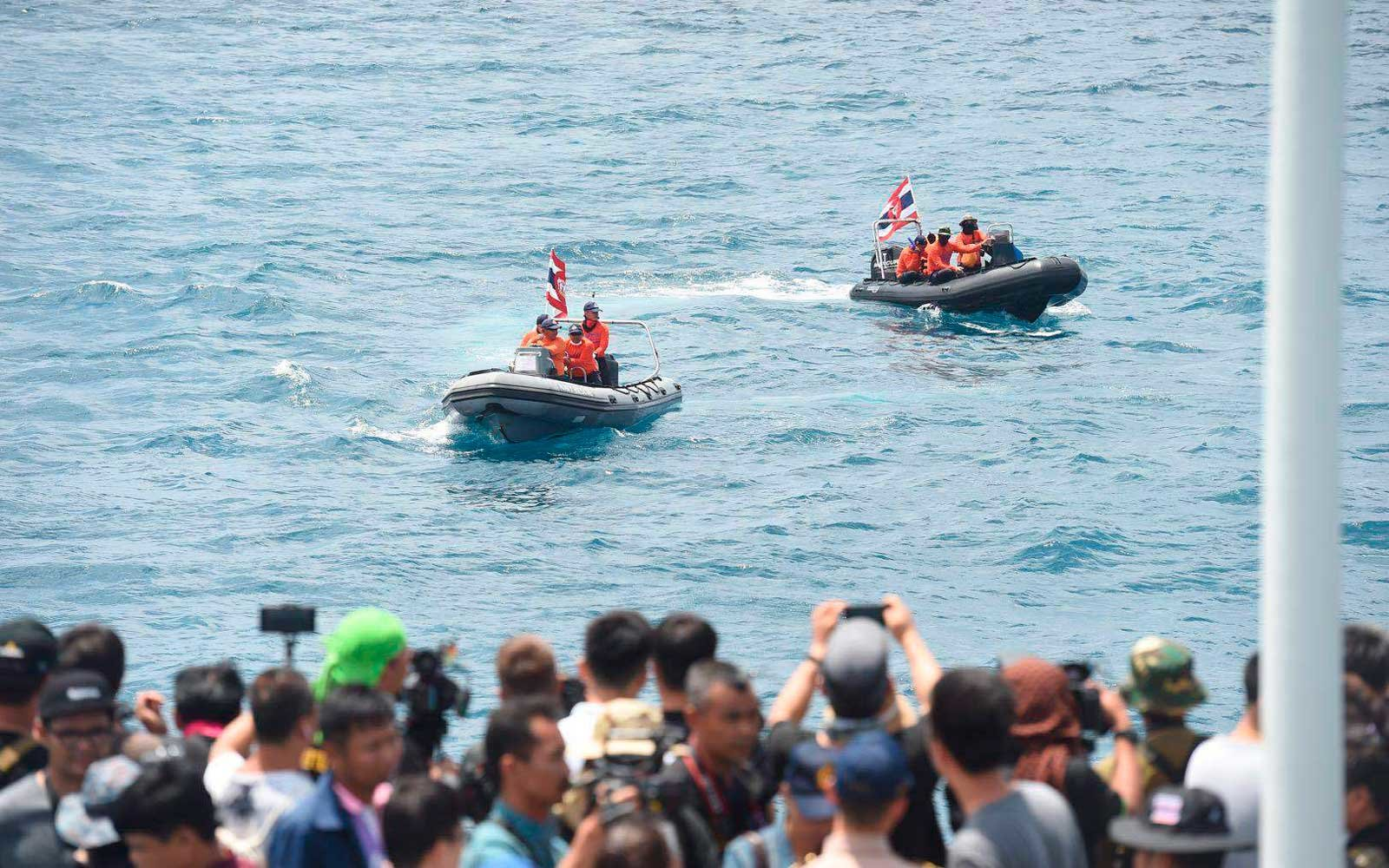 Thai rescue boats search for missing people in Phuket Island waters after two boats carrying 127 Chinese tourists capsized in Phuket, Thailand, 8 July 2018.