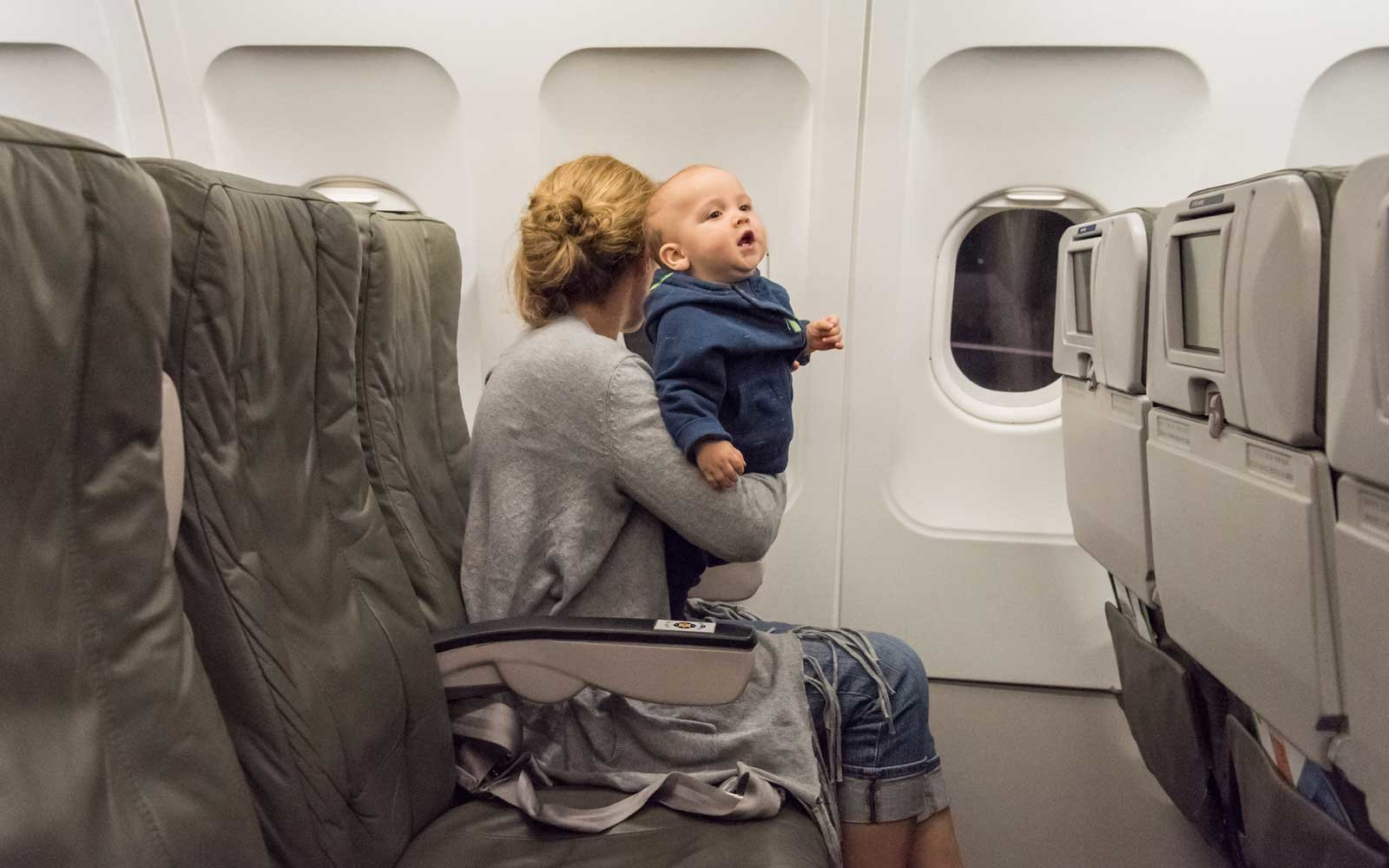 Woman traveling with her baby