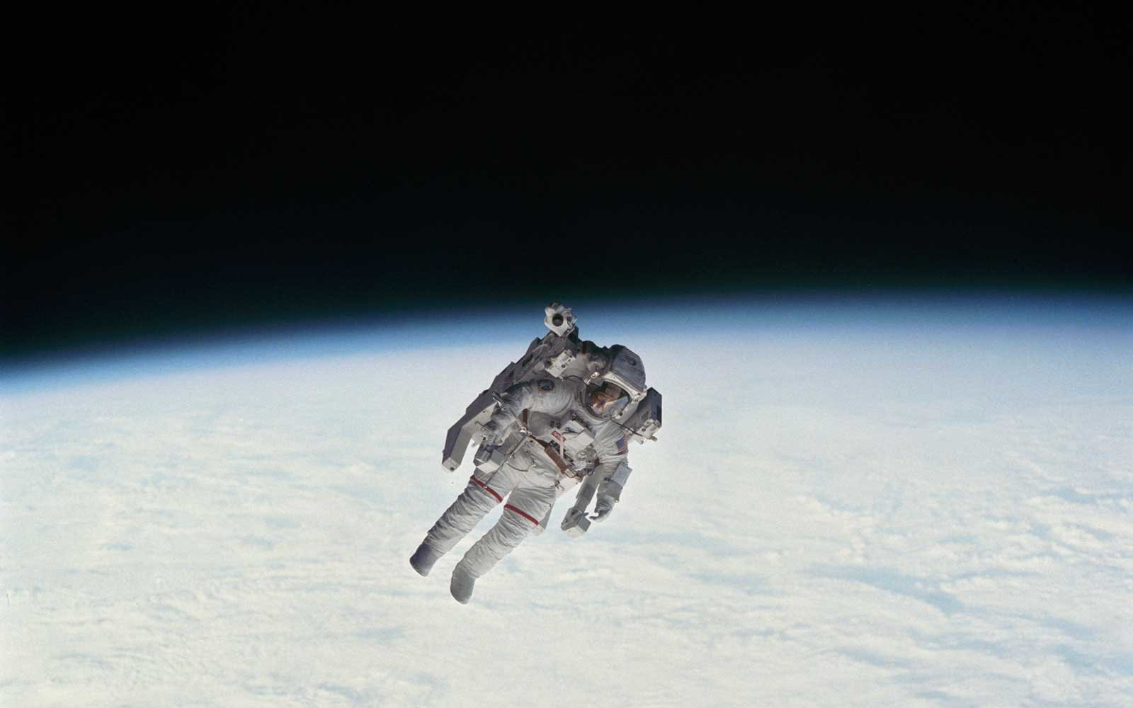 Astronauts activities during Extravehicular Activity (EV)-1. Here Astronaut Robert Stewart during Manned Maneuvering Unit (MMU) Exercise untethered above the Earth.Date: February 11, 1984