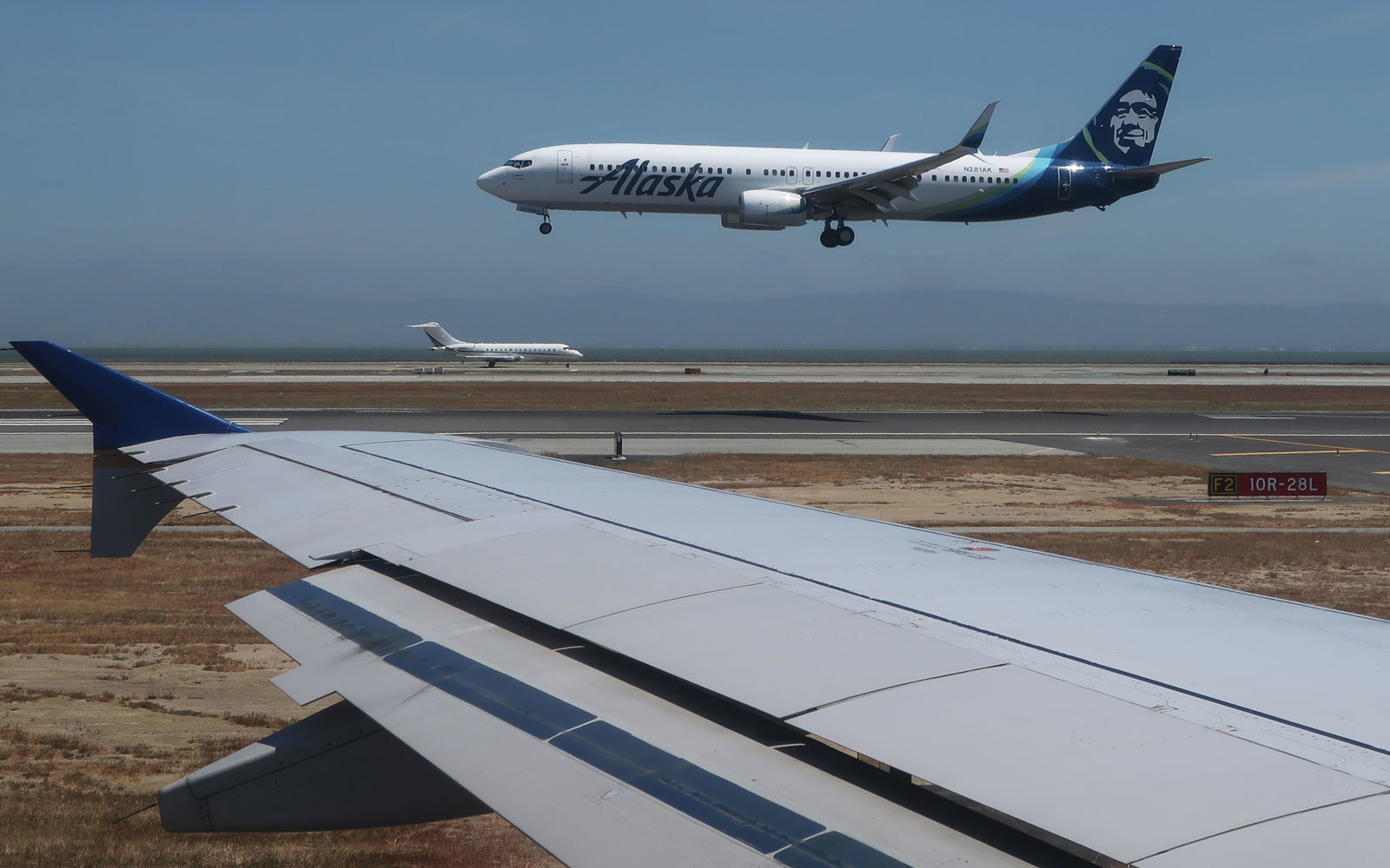 An Alaska Airlines aircraft takes to the skies.
