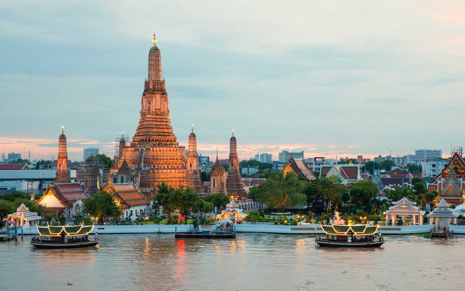 Wat Arun and cruise ship in night, Bangkok city, Thailand